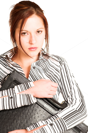 Business Woman #337 stock photo, Business woman with brown hair, dressed in a white shirt with black stripes. Holding a black leather suitcase. Serious by Sean Nel
