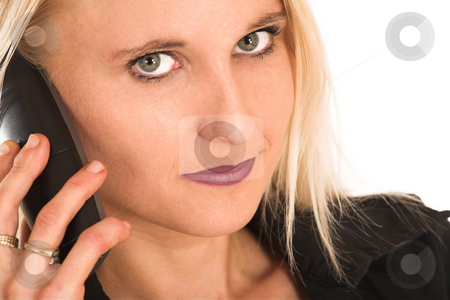 Businesswoman#368 stock photo, Blond Business Woman, eyes open, talking on phone, serious, one eye out of focus by Sean Nel