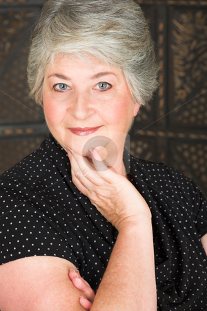 Elderly Italian woman stock photo, Beatiful older caucasian woman in black blouse, with blue-grey eyes and silver hair. by Sean Nel