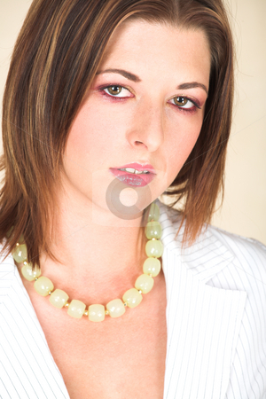 Young adult businesswoman stock photo, Young Caucasian adult businesswoman in a white pinstripe suit by Sean Nel