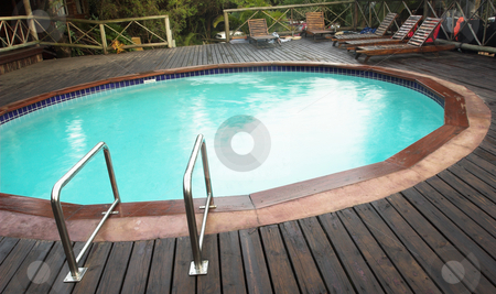 Outdoor Swimmingpool stock photo, Exterior of a swimming pool in a lodge in Sudwana, South Africa. by Sean Nel