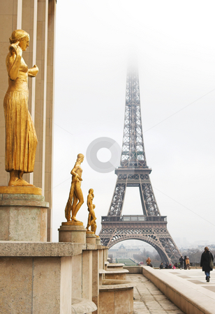 Paris #67 stock photo, A golden statue in the foreground with the Eiffel Tower in Paris, France.  Copy space. by Sean Nel