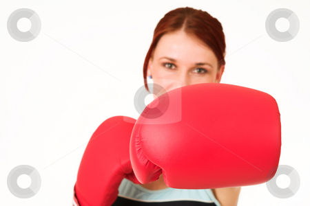 Gym #45 stock photo, Woman wearing boxing gloves.  Shallow d.o.f  -  face out of focus, gloves in focus. by Sean Nel