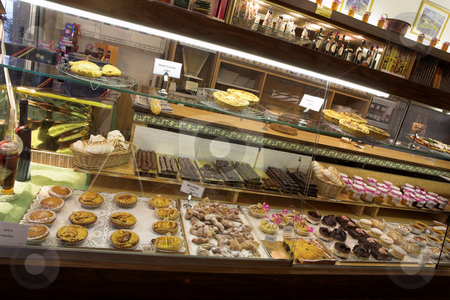 Patisserie in France stock photo, All kinds of pastries on shelves in patisserie in France by Sean Nel