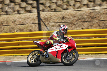 Superbike #60 stock photo, High speed Superbike on the circuit  by Sean Nel