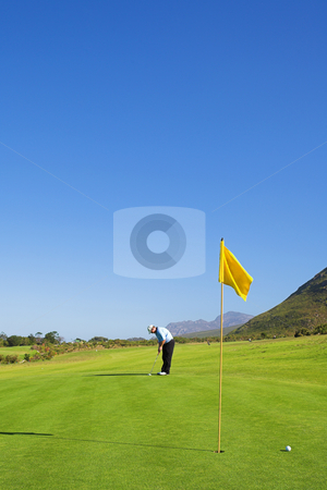 Golfer #44 stock photo, A golfer playing golf on a green. by Sean Nel