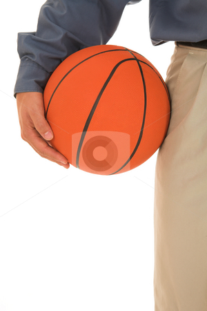 Coach #21 stock photo, Man holding a basketball next to him. by Sean Nel