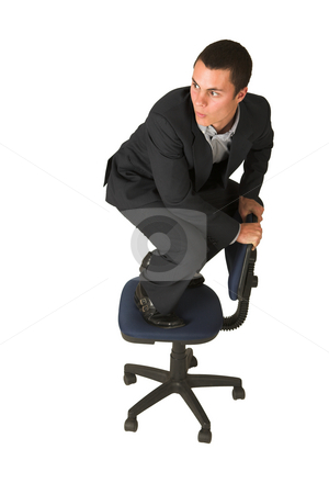 Businessman #232 stock photo, Businessman wearing a suit and a grey shirt.  Making a stunt on an office chair by Sean Nel