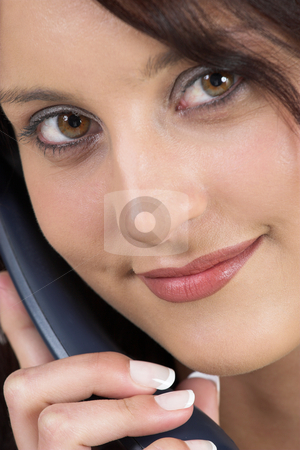 Luzaan Roodt #1 stock photo, Business woman in formal black suit, holding a phone - close-up by Sean Nel