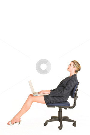 Laura Hopton #1 stock photo, Business woman on office chair with Laptop on her lap - looking up, copy space by Sean Nel