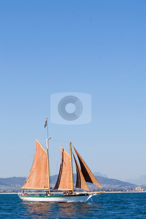 Yacht #6 stock photo, White Yacht, orange sail - copy space by Sean Nel