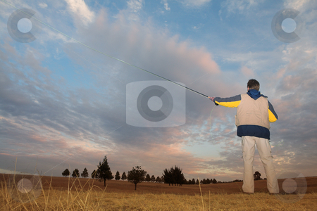 Flyfishing #3 stock photo, A fly fisherman casting a line in Dullstroom, South Africa by Sean Nel
