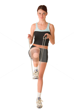 Gym #168 stock photo, Woman in gym wear standing on one leg holding foot with skipping rope. by Sean Nel