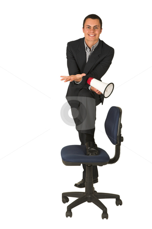 Businessman #254 stock photo, Businessman wearing a suit and a grey shirt.  Making a stunt on an office chair with a megaphone in his hand by Sean Nel