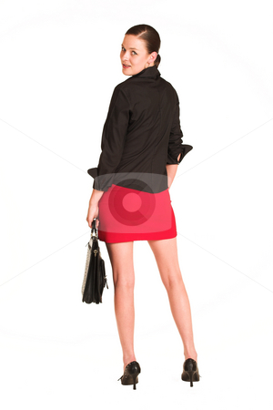 Business Woman #10 stock photo, Business woman dressed in a black shirt and red skirt.  Holding a leather suitcase by Sean Nel