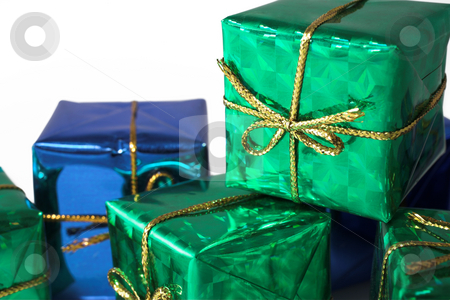Gift #3 stock photo, Blue and green wrapped gifts with golden ribbon by Sean Nel
