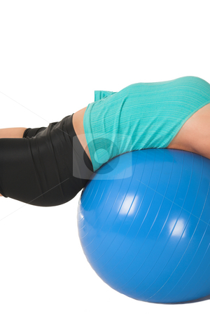 Gym #169 stock photo, Woman in gym wear laying on her back on blue ball. by Sean Nel