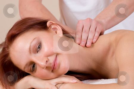 Massage #35 stock photo, Woman lying on massage table with the hands of male masseuse on her back and shoulders by Sean Nel