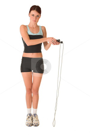 Gym #161 stock photo, Woman looking serious in gym wear holding skipping rope. by Sean Nel