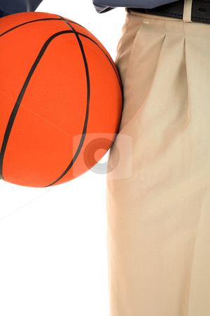 Coach #20 stock photo, Man holding a basketball. by Sean Nel