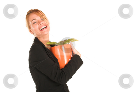 Businesswoman #240 stock photo, Blonde business lady in formal black suit.  Holding a potplant and laughing - Copy Space by Sean Nel