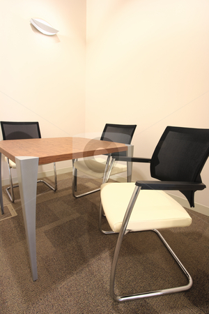 Small boardroom stock photo, Empty office boardroom with new modern office furniture, including one table and three chairs. HDR type image by Sean Nel