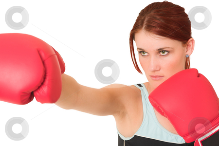 Gym #61 stock photo, Woman wearing boxing gloves.  Looking serious. Shallow d.o.f  -  face in focus, gloves out of focus. by Sean Nel