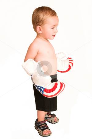 Clayton Booysen #3 stock photo, Todler standing with big boxing gloves. by Sean Nel