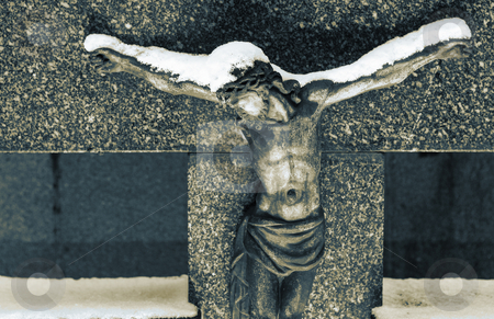 Kirchberg #06 stock photo, Gravestone  with statue of Christ covered in snow.  Sepia and blue tone. by Sean Nel