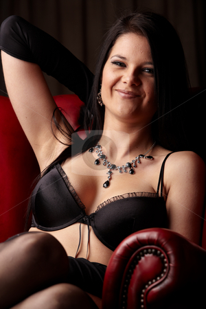 Woman in Lingerie stock photo, Sexy young adult caucasian woman in black lingerie with high contrast lighting by Sean Nel