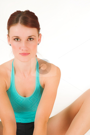 Gym #20 stock photo, A woman in gym clothes, stretching by Sean Nel
