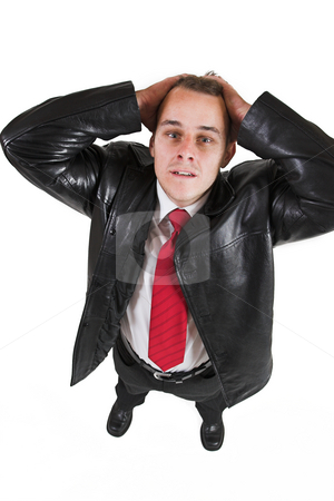 Tollie Booysen #1 stock photo, Businessman in black leather jacket, white shirt and red tie - hands on his head, looking upwards by Sean Nel
