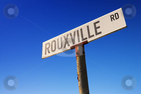 Sign against blue sky stock photo, Weathered old road sign against a clear blue sky by Sean Nel