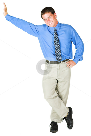 Young adult businessman standing against copy space stock photo, Young adult businessman standing against empty space. He is smiling and in office wear, and is isolated on white so that he can be added to composition images with copy space. by Sean Nel