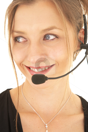 Sexy brunette businesswoman stock photo, Sexy young adult Caucasian businesswoman in a formal black dress on a white background with a headset, not isolated by Sean Nel