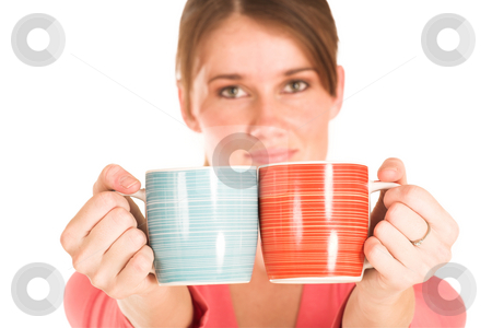 Business Woman #431 stock photo, Brunette business woman in  an informal light pink shirt.  Holding two cups.  Shallow depth-of-field - cups in focus, face out of focus. by Sean Nel
