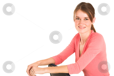 Businesswoman #414 stock photo, Brunette business lady in pink top.  Sitting on an office chair.  Copy space by Sean Nel