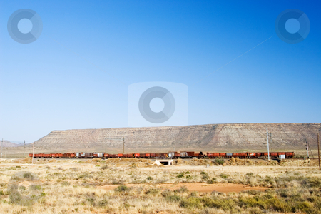 Travel #5 stock photo, Landscape of a dry area in South Africa, with train. by Sean Nel