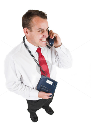 Tollie Booysen #26 stock photo, Businessman in black trousers, white shirt and red tie. Talking on the phone by Sean Nel