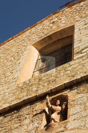 Building with window and statue stock photo, Building with window and statue in the little French hilltop village of Saint-Paul de Vence, Southern France, Alpes Maritimes, next to the Mediterranean sea by Sean Nel