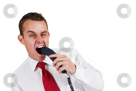 Tollie Booysen #16 stock photo, Businessman in, white shirt and red tie. Biting the telephone, one eye open by Sean Nel