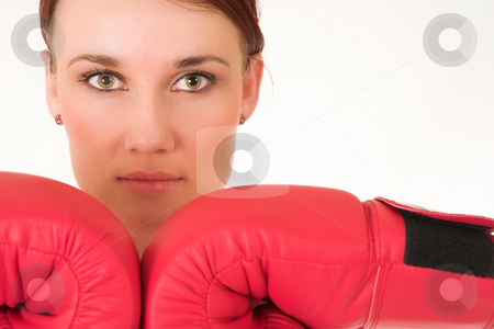 Gym #28 stock photo, A woman in gym clothes, wearing red boxing gloves by Sean Nel