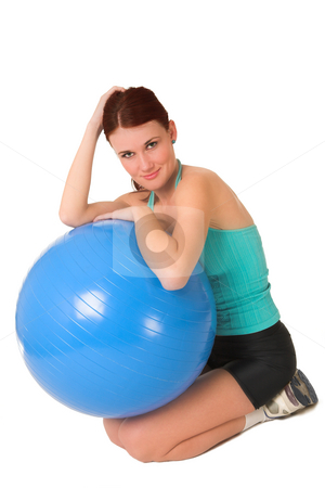 Gym #58 stock photo, Woman sitting next to a blue gym ball. by Sean Nel