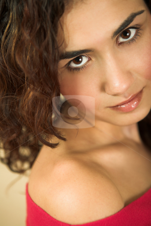 Young adult woman stock photo, Portrait of a beautiful young adult Caucasian woman with light skin and curly brown hair, brown eyes and pink lips, wearing a red top. Shallow Depth of Field by Sean Nel