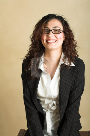 Young adult businesswoman stock photo, Portrait of a beautiful young adult Caucasian businesswoman with light skin and curly brown hair, brown eyes and pink lips, wearing a pinstripe Jacket and white shirt with spectacles by Sean Nel