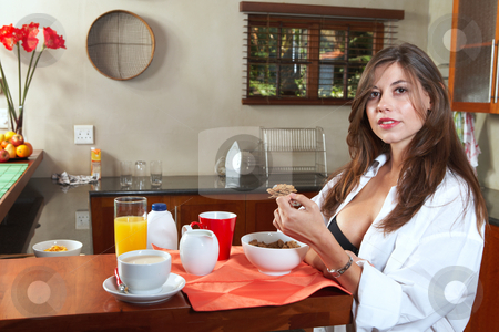 Sexy brunette eating breakfast stock photo, Sexy young adult brunette woman in black lingerie eating breakfast and drinking coffee in her kitchen by Sean Nel