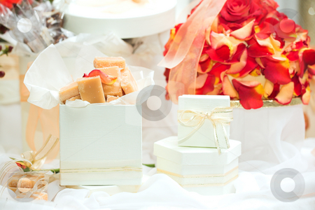 Caramel fudge confectionery stock photo, Caramel fudge confectionery and white gift boxes with ribbons as wedding guest gifts and table decorations by Sean Nel