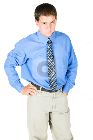 Young adult businessman standing very serious stock photo, Young adult businessman standing with a serious look/expression on his face. He is in office wear, and is isolated on white so that he can be added to composition images with copy space. by Sean Nel