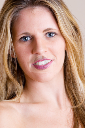 Faces #11 stock photo, Face of a young blonde woman with blue eyes by Sean Nel