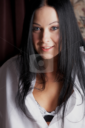 Sexy adult woman stock photo, Sexy young adult Caucasian woman with black hair, smooth skin and blue contact lenses in her eyes. by Sean Nel